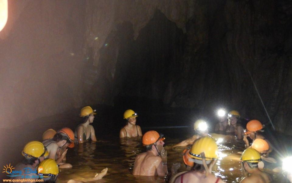 Mud bath in the Dark cave tourist area, Quang Binh