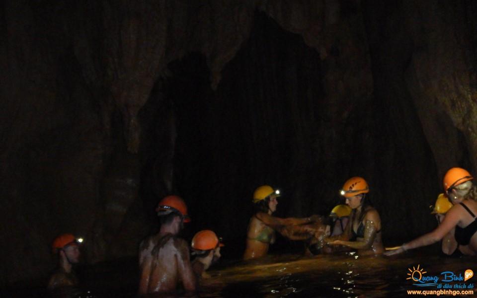 Mud bath in the Dark cave tourist area, Vietnam