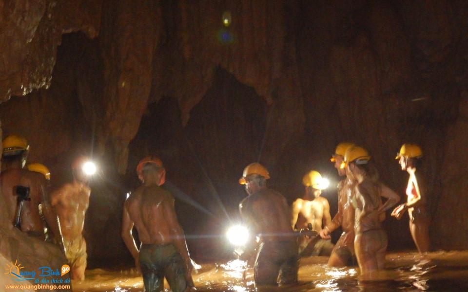Mud bath in the Dark cave tourist area